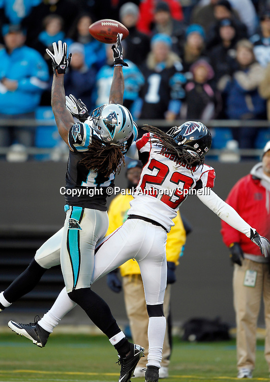 Carolina Panthers wide receiver Legedu Naanee (17) reaches for a pass broken up by Atlanta Falcons cornerback Dunta Robinson (23) during the fourth quarter of the NFL week 14 football game against the Atlanta Falcons on Sunday, December 11, 2011 in Charlotte, North Carolina. The Falcons won the game 31-23. ©Paul Anthony Spinelli