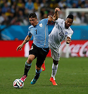 Cristian Rodríguez of Uruguay and Raheem Sterling of England during the 2014 FIFA World Cup match at Arena Corinthians, Sao Paulo<br /> Picture by Andrew Tobin/Focus Images Ltd +44 7710 761829<br /> 19/06/2014