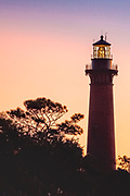 Currituck Beach Lighthouse at dawn in Corolla on the Outer Banks of NC.