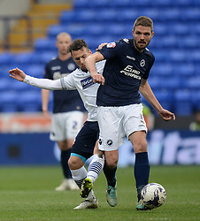 Bolton Wanderers' Adam Le Fondre competes with Millwall's Jos Hooiveld - Photo mandatory by-line: Richard Martin-Roberts/JMP - Mobile: 07966 386802 - 14/03/2015 - SPORT - Football - Bolton - Macron Stadium - Bolton Wanderers v Millwall - Sky Bet Championship