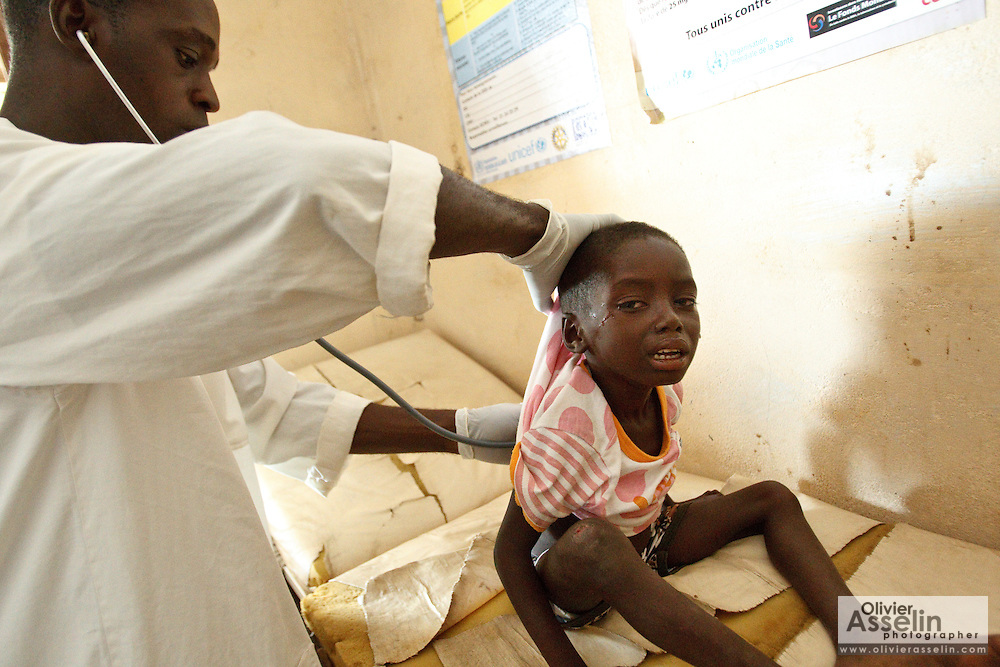 Kambou Sansan, 4, a malnourished boy, is examined by medical staff during a visit at the Panzarani health center in the village of Panzarani, Zanzan region, Cote d'Ivoire on Friday November 25, 2011.