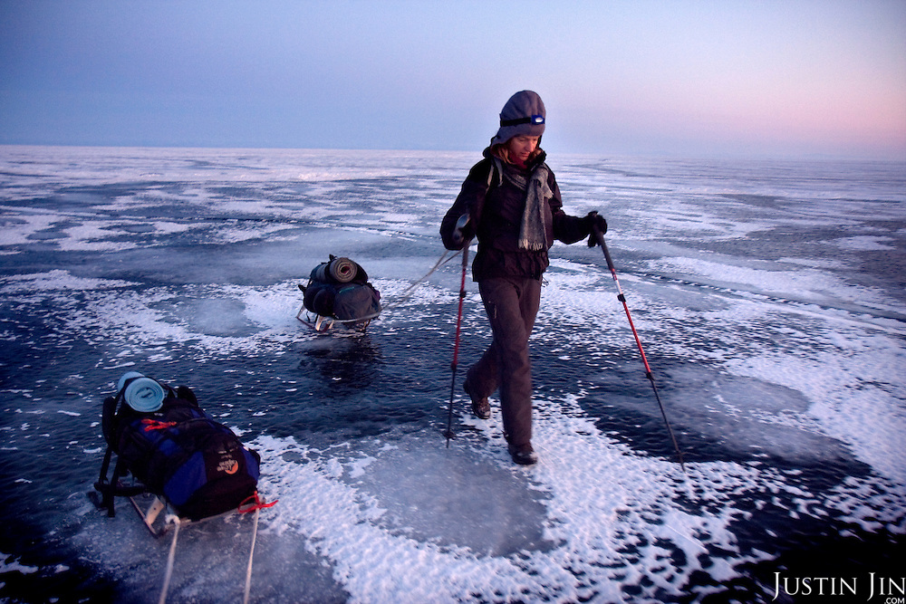 Heleen treks across frozen Lake Baikal in Siberia, Russia (second day). .They are a group of five people: Justin Jin (Chinese-British), Heleen van Geest (Dutch), Nastya and Misha Martynov (Russian) and their Russian guide Arkady. .They pulled their sledges 80 km across the world's deepest lake, taking a break on Olkhon Island. They slept two nights on the ice in -15c. .Baikal, the world's largest lake by volume, contains one-fifth of the earth's fresh water and plunges to a depth of 1,637 metres..The lake is frozen from November to April, allowing people to cross by cars and lorries.