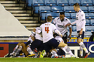Bolton Wanderers players celebrate scoring the opening goal against Millwall during the Sky Bet Championship match at The Den, London<br /> Picture by David Horn/Focus Images Ltd +44 7545 970036<br /> 19/12/2014