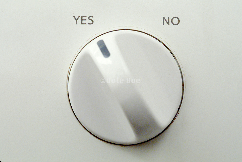 detail of washing machine knob set to yes