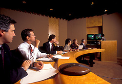 Stock photo of a presentation during a business meeting