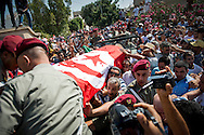© Benjamin Girette / IP3 PRESS : July 27th, 2013 : Tunisians carry the coffin of Tunisian opposition politician Mohammed Brahmi during the funeral outside his home in Tunis. Mohamed Brahmi was shot 14 times in front of his home within sight of his family on Thursday, plunging the country into a political crisis and unleashing demonstrations around the country blaming the government for the assassination.