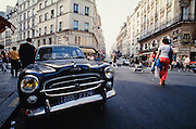 Typical neighbourhood (quartier) with vintage Peugeot 403.
