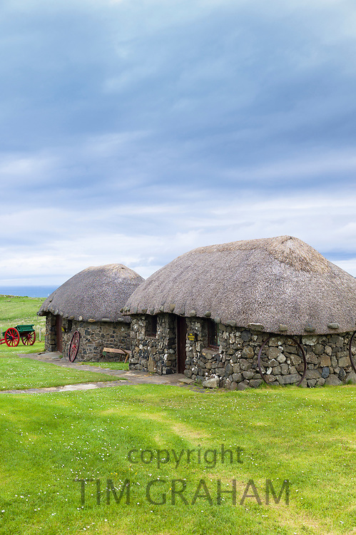 Tourist attraction Skye Museum of Village Life depicts thatched stone cottages and barns in ancient crofting housing at Kilmuir, Isle of Skye, the Western Isles of Scotland, UK