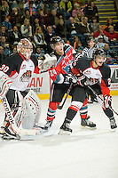 KELOWNA, CANADA, OCTOBER 26: Tyson Baillie #24 of the Kelowna Rockets checks Reid Jackson #29 of the Prince George Cougars while Drew Owsley #30 defends the net as the Prince George Cougars visit the Kelowna Rockets  on October 26, 2011 at Prospera Place in Kelowna, British Columbia, Canada (Photo by Marissa Baecker/Shoot the Breeze) *** Local Caption *** Tyson Baillie; Reid Jackson; Drew Owsley;