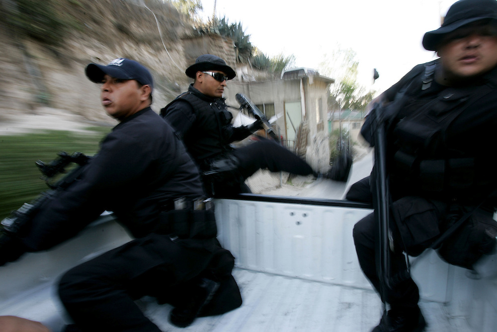 Tijuana Police agents in route to a neighborhood to search for illegal contraband during a drug sweep in Colonia Chula Vista  in Tijuana, Mexico.