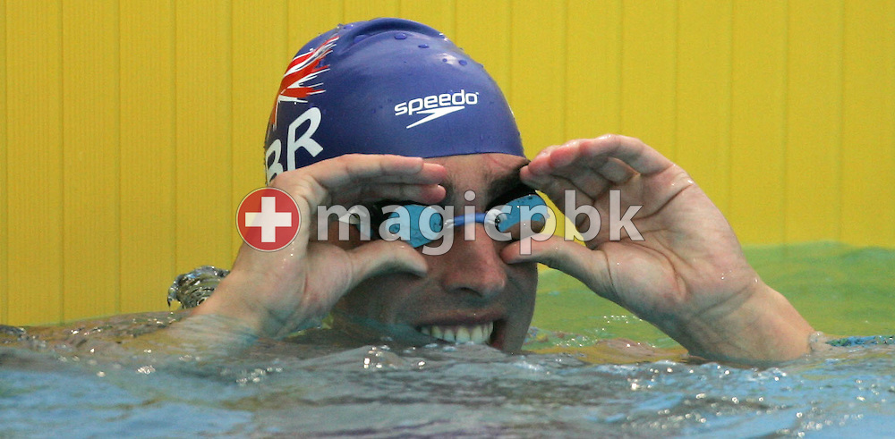 Great Britain's Chris Cook looks towwards the scoreboard after finishing first  in the semi-final of the men's 50m Breaststroke at the FINA World Championships in Montreal, Canada Tuesday 26 July, 2005.  (Photo by Patrick B. Kraemer / MAGICPBK)