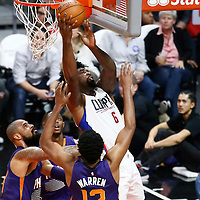 31 October 2016: Los Angeles Clippers center DeAndre Jordan (6) goes for the layup over Phoenix Suns center Tyson Chandler (4) and Phoenix Suns forward T.J. Warren (12) during the Los Angeles Clippers 116-98 victory over the Phoenix Suns, at the Staples Center, Los Angeles, California, USA.