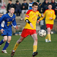 Avenue's Captain Donal O'Halloran in action against Ennis Town.<br />Photograph by Flann Howard