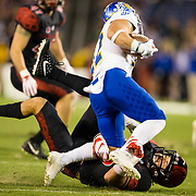20 October 2018: San Diego State Aztecs special teams Marc Ellis (35) makes an open field tackle on San Jose State Spartans kick returner Thai Cottrell (22) on a kick off return in the second half. The Aztecs beat the Spartans 16-13 Saturday night at SDCCU Stadium.