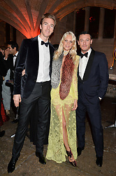 Left to right, JAMES COOK, POPPY DELEVINGNE and LUKE EVANS Save the Children and Bulgari Ambassador, at Save the Children's spectacular, black tie Winter Gala, a festive fundraising event held at London's Guildhall. Guests were transported into the magical world of the much-celebrated British novelist, Roald Dahl, in celebration of his centenary, for a marvellous evening of fine dining and gloriumtious entertainment to raise money to help transform children's lives across the world and here in the UK.