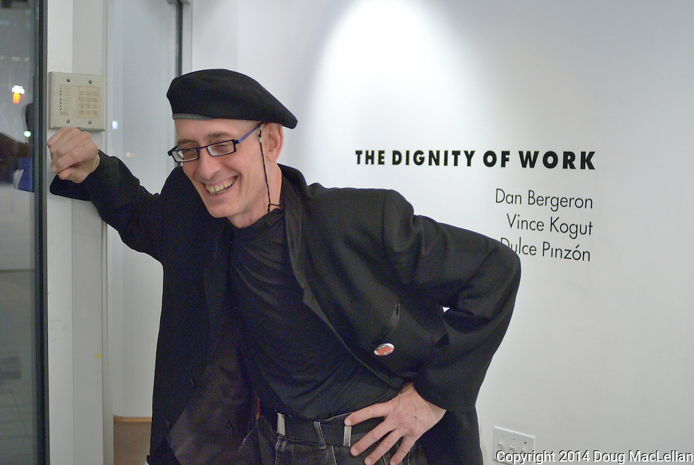 "Bernie Helling of Artcite Inc. relaxed a bit after the opening reception of ""The Dignity of Work' a group show that is part of MayWorks Windsor 2014."