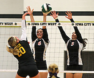 Springville's Christine Hoogland (6) and Tracy Kilburg (3) try to block a shot by New London's Josten Boyer (20) in the Class 1A regional final match at Iowa City West High School in Iowa City on Wednesday, November 6, 2013. Springville defeated New London 3-2.