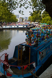 Little Venice, London, April 30th 2017. Narrowboaters from all over the uK gather for the annual Canalway Cavalcade, held on the May Day Bank holiday weekend, organised by the Inland Waterways Association, where boaters get the chance to display their immaculately prepared and brightly painted craft as well as compete in various manoeuvring tests. PICTURED: Narrowboats are moored in Paddington Basin where the Regents and Grand Union canals meet.<br /> Credit: &copy;Paul Davey<br /> To licence contact: <br /> Mobile: +44 (0) 7966 016 296<br /> Email: paul@pauldaveycreative.co.uk<br /> Twitter: @pauldaveycreate