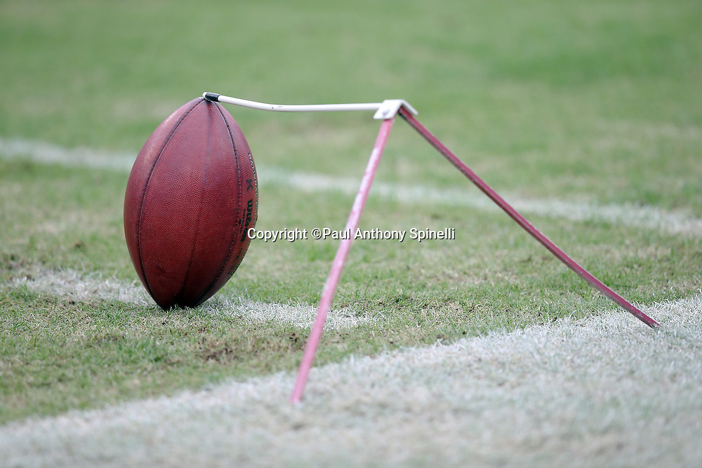 A football is teed up on a metal tee before the Tennessee Titans 2015 week 7 regular season NFL football game against the Atlanta Falcons on Sunday, Oct. 25, 2015 in Nashville, Tenn. The Falcons won the game 10-7. (©Paul Anthony Spinelli)