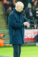 Football - 2016 / 2017 Premier League - Swansea City vs. Stoke City<br /> <br /> Swansea City manager Bob Bradley looks at his watch on the touchline towards the end of the game after his team win 2-0—, at The Liberty Stadium.<br /> <br /> COLORSPORT/WINSTON BYNORTH