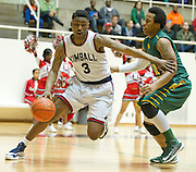 D'Angelo Allen (3) of Kimball drives to the basket against the Carrollton Newman Smith in the Class 4A area-round playoff game Friday, February 22, 2013 at the Alfred J. Loos Field House in Addison, Texas. (Cooper Neill/The Dallas Morning News)