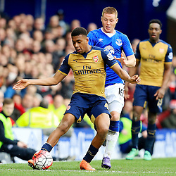 Arsenal's Alex Iwobi battles with Everton's James McCarthy  - Mandatory byline: Matt McNulty/JMP - 19/03/2016 - FOOTBALL - Goodison Park - Liverpool, England - Everton v Arsenal - Barclays Premier League