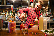 Astoria, NY - 8 December 2016. Bartender Andy Donohoe mixing an Astoria Sunset and an Astoria Park Paloma at The Pomeroy.