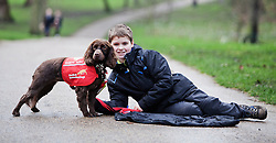 © Licensed to London News Pictures. 18/02/2014. London, UK. Steven Courtney with his dog Molls. Molls alerts Steven to hypo's and hyperglycaemia, helping to keep him safe. The Kennel Club announces the shortlisted finalists of the Crufts dog hero competition at Green Park, London, today 18th February 2014. Photo credit : Andrea Baldo/LNP