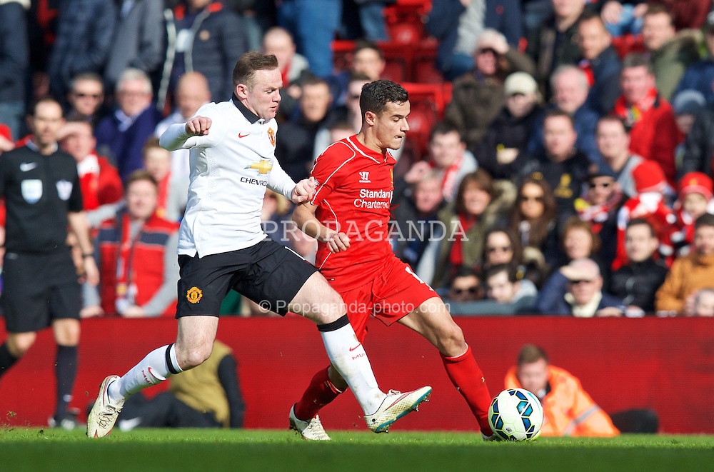 LIVERPOOL, ENGLAND - Sunday, March 22, 2015: Liverpool's Philippe Coutinho Correia in action against Manchester United's Wayne Rooney during the Premier League match at Anfield. (Pic by David Rawcliffe/Propaganda)