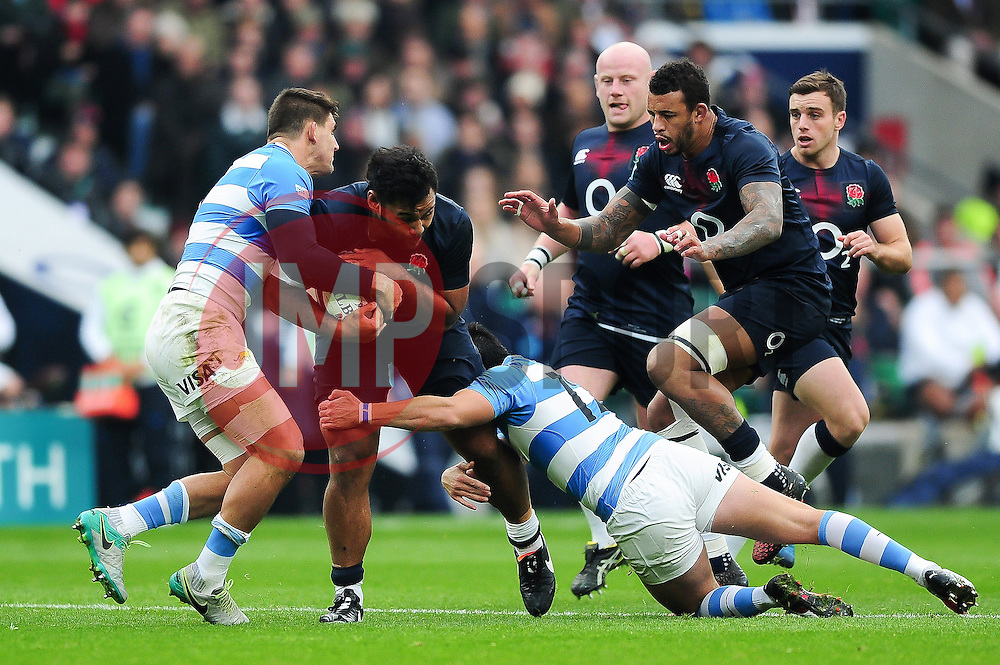 Billy Vunipola of England takes on the Argentina defence - Mandatory byline: Patrick Khachfe/JMP - 07966 386802 - 26/11/2016 - RUGBY UNION - Twickenham Stadium - London, England - England v Argentina - Old Mutual Wealth Series.