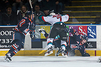 KELOWNA, CANADA - MARCH 24: Lucas Johansen #7 of the Kelowna Rockets checks Rudolfs Balcers #21 of the Kamloops Blazers into the boards during first period on March 24, 2017 at Prospera Place in Kelowna, British Columbia, Canada.  (Photo by Marissa Baecker/Shoot the Breeze)  *** Local Caption ***
