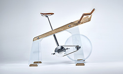 "April 3, 2017 - inconnu - An exercise bike which doubles as a classy piece of furniture could be a hit with exercise fans who don't have room for a home gym.Italian company Adriano Design said the glass and wood Fuoripista represents a new way of interpreting a fitness accessory.The company says it lets users enjoy a spin without compromise, on a machine you won't have to hide under the bed, in the closet or the basement.Bracket on the front for a tablet uses an app to display different terrains and data such as distance travelled and calories burned.A spokesman for the company, based in Turin, said:"" No longer gym exclusive but so beautiful that becomes an object of desire, to show off, to praise, one you would ride with pride and joy. ""A dream machine along with you would ride away some of the most spectacular cycling routes in the world, virtualised on a tablet mounted on its front. ""It was created by Adriano Design to mark 20 years of the SaloneSatellite design show in Milan this year.It is part of a collection nominated SaloneSatellite 20 anni of pieces designed specifically for the occasion by international designers.Adriano has previously reinvented the foosball table with Teckell, the pool table with Filotto and ping pong table with Lungolinea of Impatia.# VELO D'APPARTEMENT DESIGN (Credit Image: © Visual via ZUMA Press)"