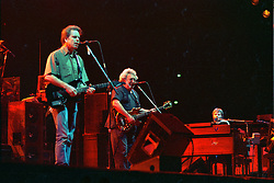Bob Weir, Jerry Garcia and Brent Midland in performance with The Grateful Dead Live at The Civic Center, Hartford Connecticut 18 March 1990. Stage close, in The Pit, image capture.