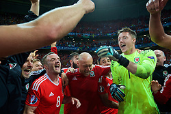 LILLE, FRANCE - Friday, July 1, 2016: Wales' Andy King, David Cotterill and goalkeeper Wayne Hennessey celebrate in the team huddle after the 3-1 victory over Belgium during the UEFA Euro 2016 Championship Quarter-Final match at the Stade Pierre Mauroy. (Pic by David Rawcliffe/Propaganda)