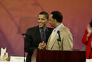 Illinois State Senator and Democratic candidate for the U.S. Senate Barack Obama, left, poses for photos with Rev. Jesse Jackson before speaking at the Annual Rainbow/Push Coalition and Citizenship Fund Conference at the Sheraton Hotel and Towers in Chicago..