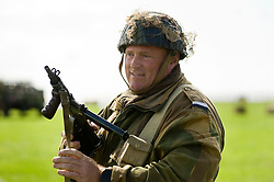 A reenactor portrays a British Paratrooper from the 6th Airborne Division during a battle re-enactment at the The first Annual Lytham 1940s Weekend held to celebrate the 70th anniversary of the battle of Britain and raise funds for a new Fighter and Bomber Command Memorial to be erected in Lytham. 21 August 2010 Images © Paul David Drabble..