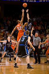 Virginia forward Mike Scott (32) and Duke guard/forward Gerald Henderson (15) leap for the opening tip.  The Virginia Cavaliers men's basketball team fell to the #6 Duke Blue Devils 86-70 at the University of Virginia's John Paul Jones Arena in Charlottesville, VA on March 5, 2008.