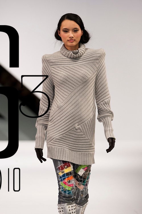 HONG KONG - JANUARY 20:  A model showcases designs by Eric Cheung on the catwalk during the International Fashion Designers' Show I as part of the  Hong Kong Fashion Week Fall/Winter 2010 on January 20, 2010 in Hong Kong.  Photo by Victor Fraile / studioEAST