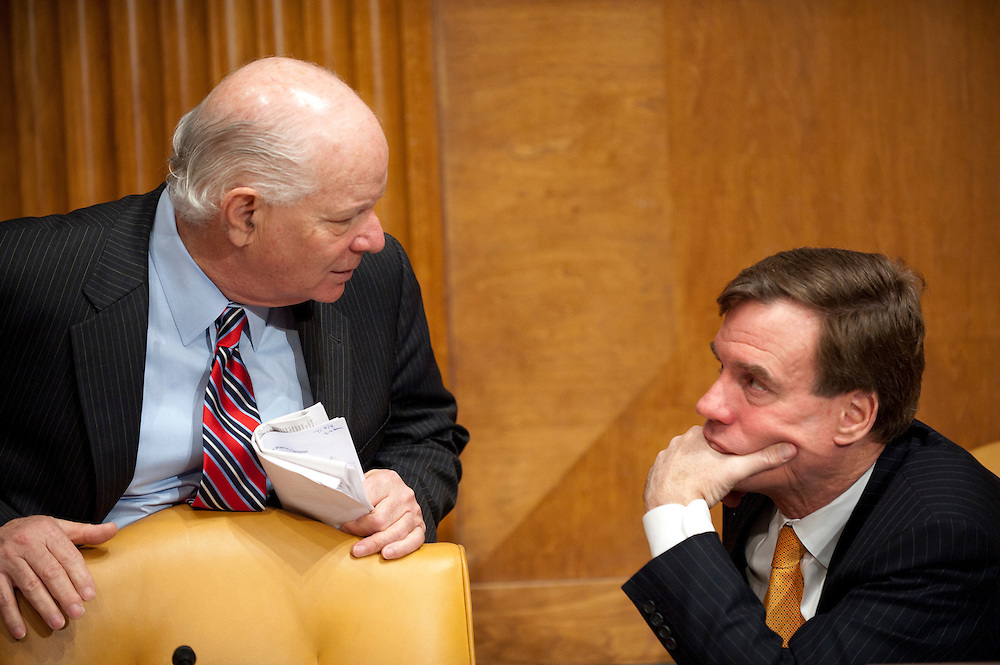 Senators BEN CARDIN (D-MD) and MARK WARNER (D-VA) confer before the start of a Senate Budget Committee Hearing on the report of the National Commission on Fiscal Responsibility and Reform.