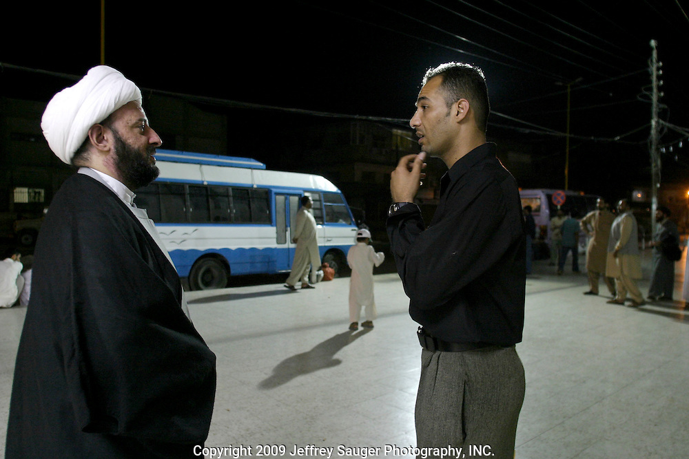 """Emad Al-kasid, right, meets talks with Sheik Mortada Maash, left, chief editor of Annabaa Magazine, after touring the office of Annabaa Magazine, www.annabaa.org and www.iraqtoday.net at the Howza of Ayotollah Shirazi the Iraqi area of Damascus, Syria, Wednesday, July 16, 2003. Al-kasid has been meeting with businessmen and media people to learn about their ways as he plans to publish a magazine...Maash said that their publications are banned in Saudi Arabia and most arabic countries. """"They talk about peace,"""" Maash says, """"The Shiite way, not the Wahabi way.'If you write anything about us, we believe in non-violence; this is what our magazines are about.""""..""""You have to write these things and tell Amercia and Europe. America must stay with the Iraqi people. They must help us and fulfill their promises of bringing democracy and freedom to our future for America's future depends on these too.""""..His wife Zainab Sahb is the chief editor of Bushra Magazine for women...A Howza is like a seminary where men come to study. In this Shiite Howza, the philosophy of Ayotollah Shirazi is taught. As with all Shiite, advocacy of non-violence is the pre-eminent rule. Hundreds of thousands of Iraqi Shiite settled in Syria after the Gulf War and their uprising against Saddam Hussein in 1991."""