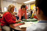 Angie Linchoten, right, gets spelling help from her teacher, Ms. Bergen, in her third grade class at Bennion Elementary School in Salt Lake City, Monday, Dec. 17, 2012.