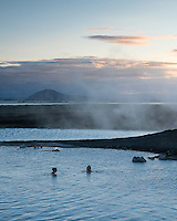 Mývatn Nature Baths - Jarðböðin by lake Mývatn, Norht Iceland. People enjoying the warm geothermal mineral rich water at sunset.