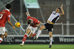 Bristol City's Aden Flint is challenged by Port Vale's Tom Pope - Photo mandatory by-line: Dougie Allward/JMP - Mobile: 07966 386802 - 10/02/2015 - SPORT - Football - Bristol - Ashton Gate - Bristol City v Port Vale - Sky Bet League One
