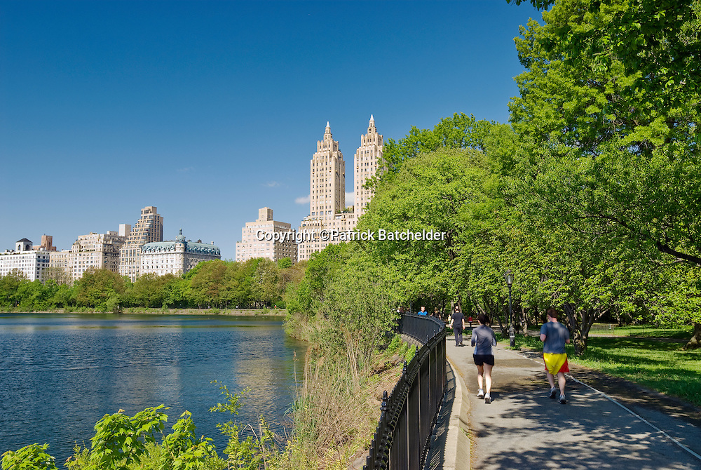 """The Jacqueline Kennedy Onassis Reservoir, """"The Reservoir,"""" and the jogging track, with a view of Central Park West and The El Dorado apartment building, Central Park, New York City."""