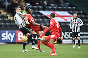 Leyton Orient striker Armand Gnanduillet battles with Notts County defender Haydn Hollis during the Sky Bet League 2 match between Notts County and Leyton Orient at Meadow Lane, Nottingham, England on 20 February 2016. Photo by Jon Hobley.