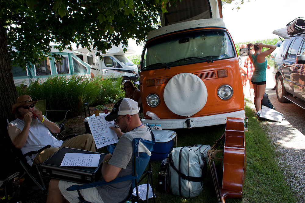 Jeff Blanchard and Jerry Hoehle go over the set list for their show at Camp Euforia in Lone Tree on Friday, July 18, 2015. The pair play guitar and bass respectively in the bluegrass band Mr. Baber's Neighbors.