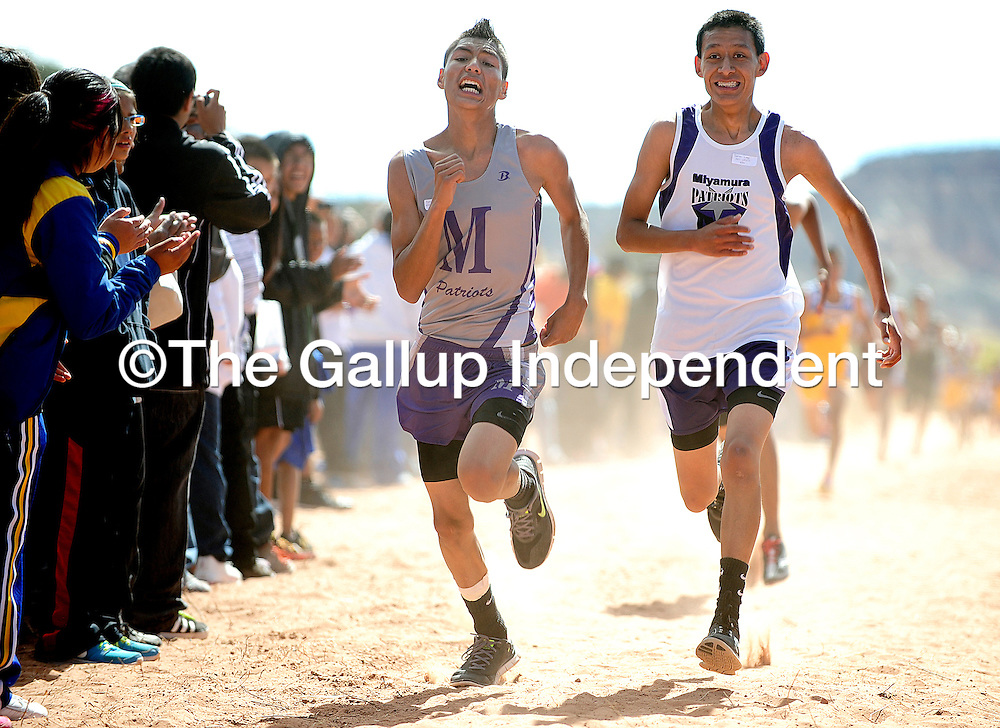 101212  Adron Gardner<br /> <br /> Miyamura Patriots and teammates Benjamin Chee, left,  and Theron Logg race to the finish in the final meters of the boys varsity race at the Zuni Invitational in Zuni Saturday.
