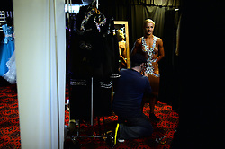 © Licensed to London News Pictures. 5 time Latin champion Yulia Zagoruychenko has a final dress fitting with designer Chris Stephenson at the British Ballroom dance championships at the Winter Gardens in Blackpool 26-05-2015. The first Blackpool Dance Festival was held  in 1920 now has 60 countries represented with total number of 2,950 couples competing. Photo credit: Nigel Roddis/LNP