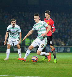 Yeovil Town's Kieffer Moore battles for the ball with Manchester United's Ander Herrera  - Photo mandatory by-line: Joe meredith/JMP - Mobile: 07966 386802 - 04/01/2015 - SPORT - football - Yeovil - Huish Park - Yeovil Town v Manchester United - FA Cup - Third Round