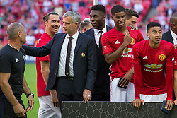 Manchester United manager Jose Mourinho celebrates with his team after Manchester United win the match 1-2 to give him his first silverware at the club  - Rogan Thomson/JMP - 07/08/2016 - FOOTBALL - Wembley Stadium - London, England - Leicester City v Manchester United - The FA Community Shield.